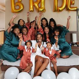 Bride & bridesmaids with ballons