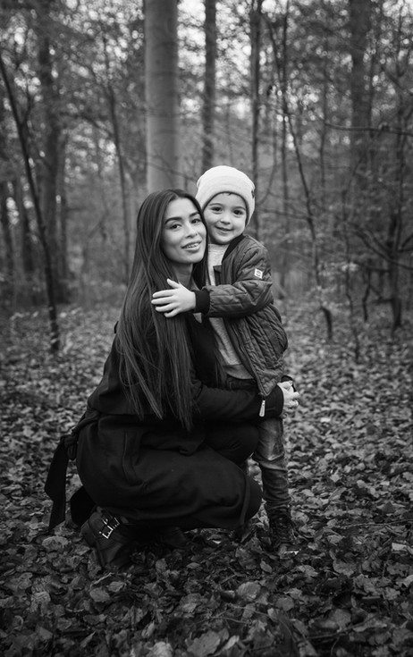 Mom and son in the forest