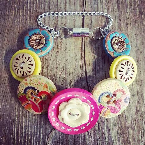 rainbows and lollipops button bracelet
