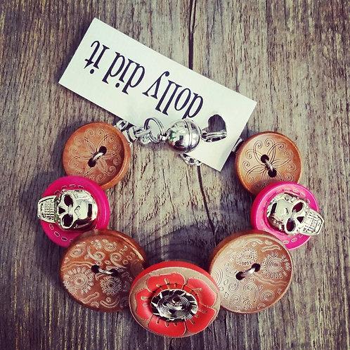 skulls r us orange & pink button bracelet