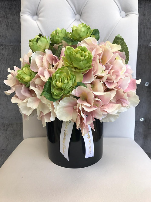BLACK CYLINDER WITH PINK HYDRANGEAS AND HOP SPRAY