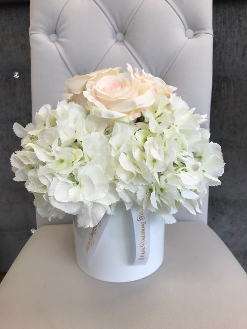 WHITE CYLINDER WITH WHITE HYDRANGEAS AND BLUSH ROSES