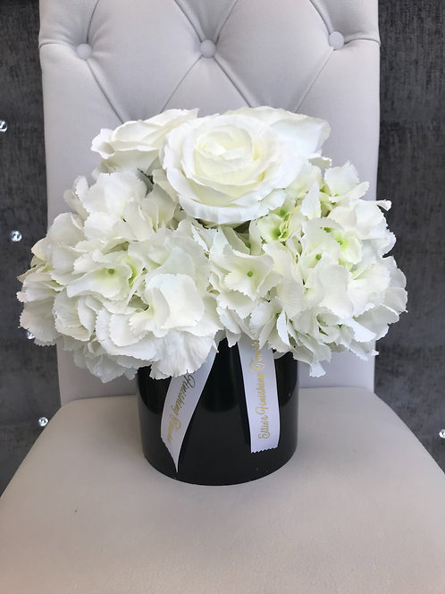 BLACK CYLINDER WITH WHITE HYDRANGEAS AND WHITE ROSES