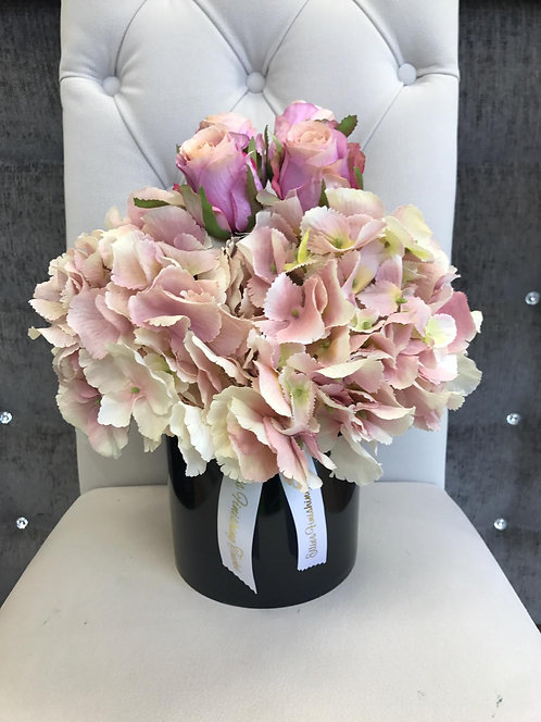 BLACK CYLINDER WITH PINK HYDRANGEAS AND HOT PINK ROSES