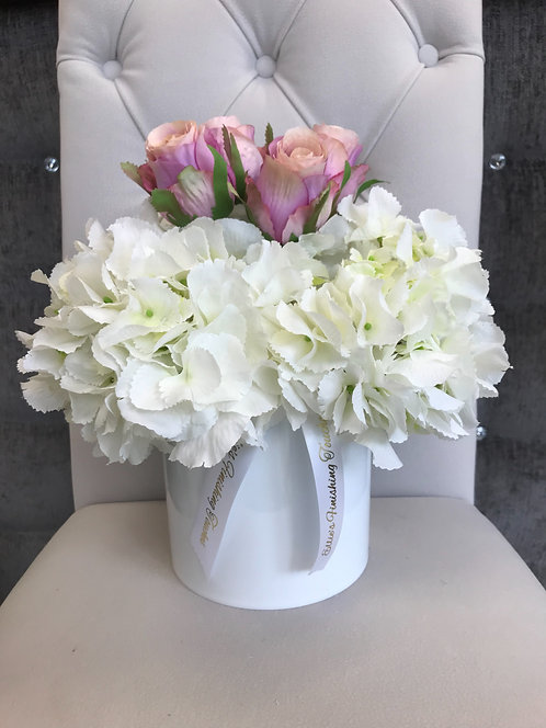 WHITE CYLINDER WITH WHITE HYDRANGEAS AND HOT PINK ROSES