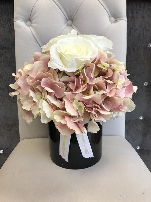 BLACK CYLINDER WITH PINK HYDRANGEAS AND WHITE ROSES
