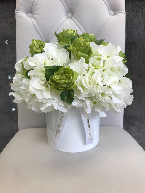 WHITE CYLINDER WITH WHITE HYDRANGEAS AND HOP SPRAY