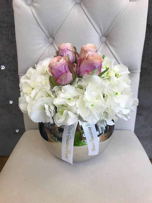 SILVER BOWL WITH WHITE HYDRANGEAS AND HOT PINK ROSES