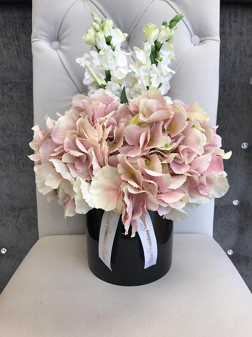 BLACK CYLINDER WITH PINK HYDRANGEAS AND STOCKS