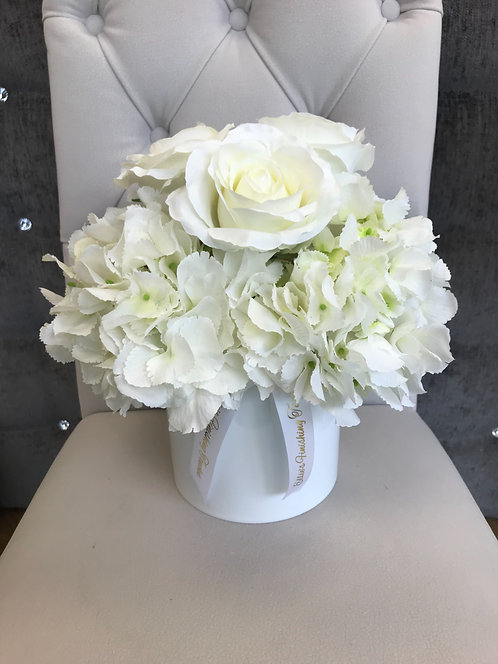 WHITE CYLINDER WITH WHITE HYDRANGEAS AND WHITE ROSES
