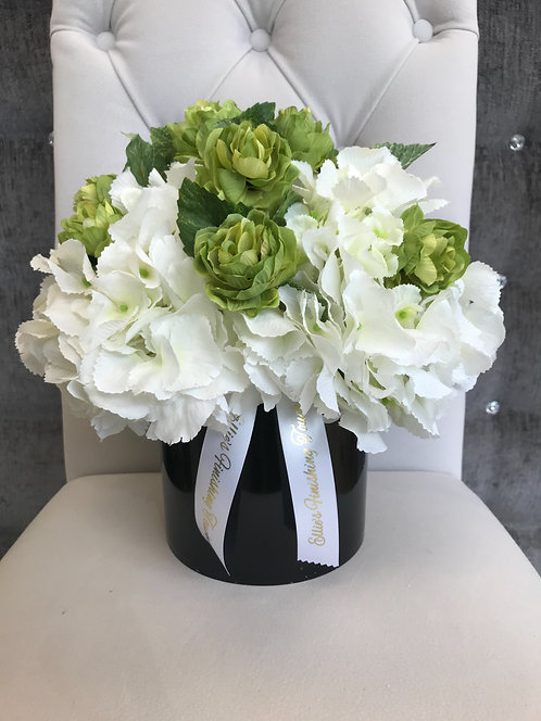 BLACK CYLINDER WITH WHITE HYDRANGEAS AND HOP SPRAY