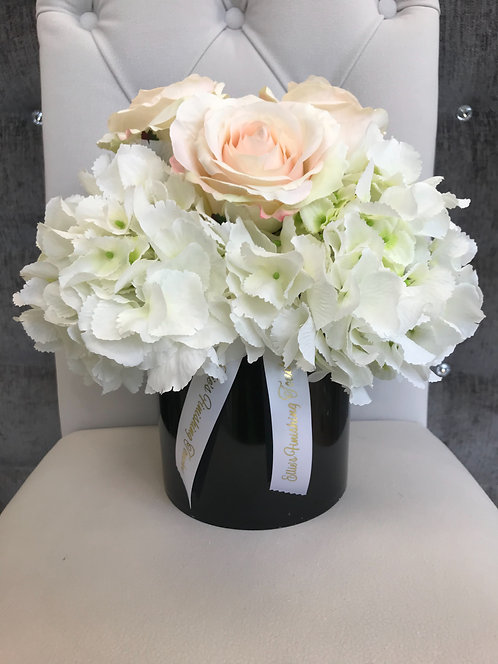 BLACK CYLINDER WITH WHITE HYDRANGEAS AND BLUSH ROSES