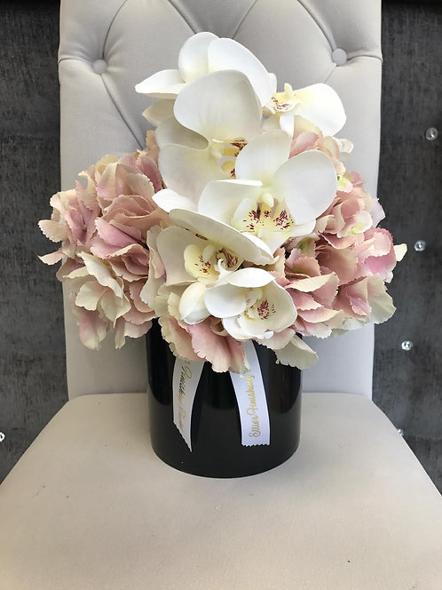 BLACK CYLINDER WITH PINK HYDRANGEAS AND ORCHID