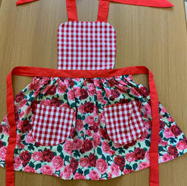 mostly red layered apron