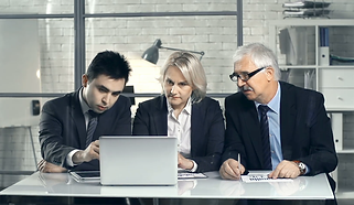 front-view-of-three-business-people-sitt