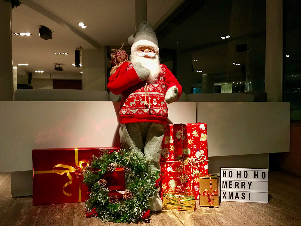 Santa with presents by our corporate event organising company