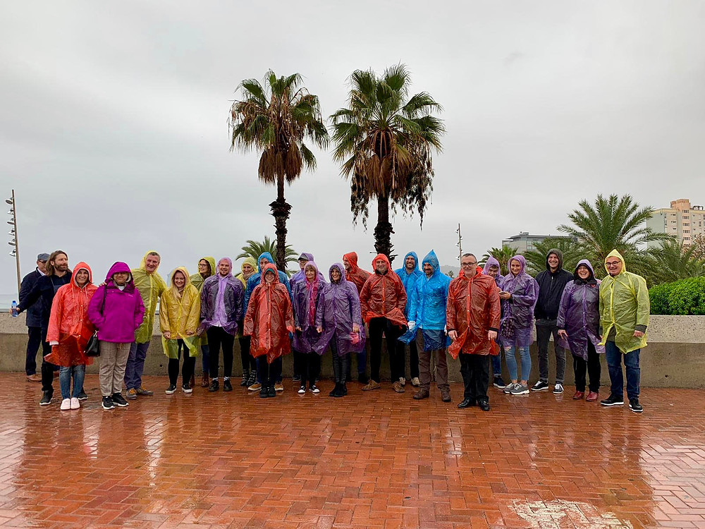 Rain coats excursion to Montjuic tour event for a company