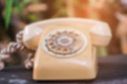 old rotary telephone on wood table.jpg