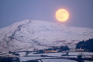 The Full Moon rising behind Beamsley Beacon