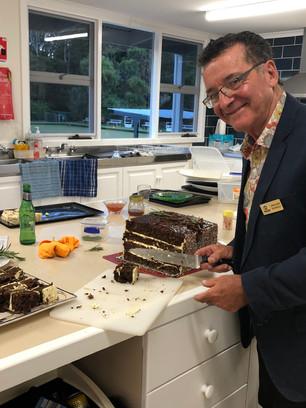 Jean Claude cutting Maryanne's cake .JPG