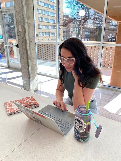 megan garcia sitting at her laptop to work