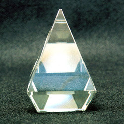 Solid glass beveled and polished pyramid for home decor or office desk display
