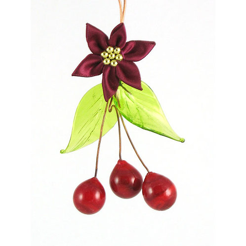 Glass fruit decorative ornament. Cranberry glass fruit with green leaves.