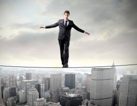 man-walking-tightrope1-284x220.jpg