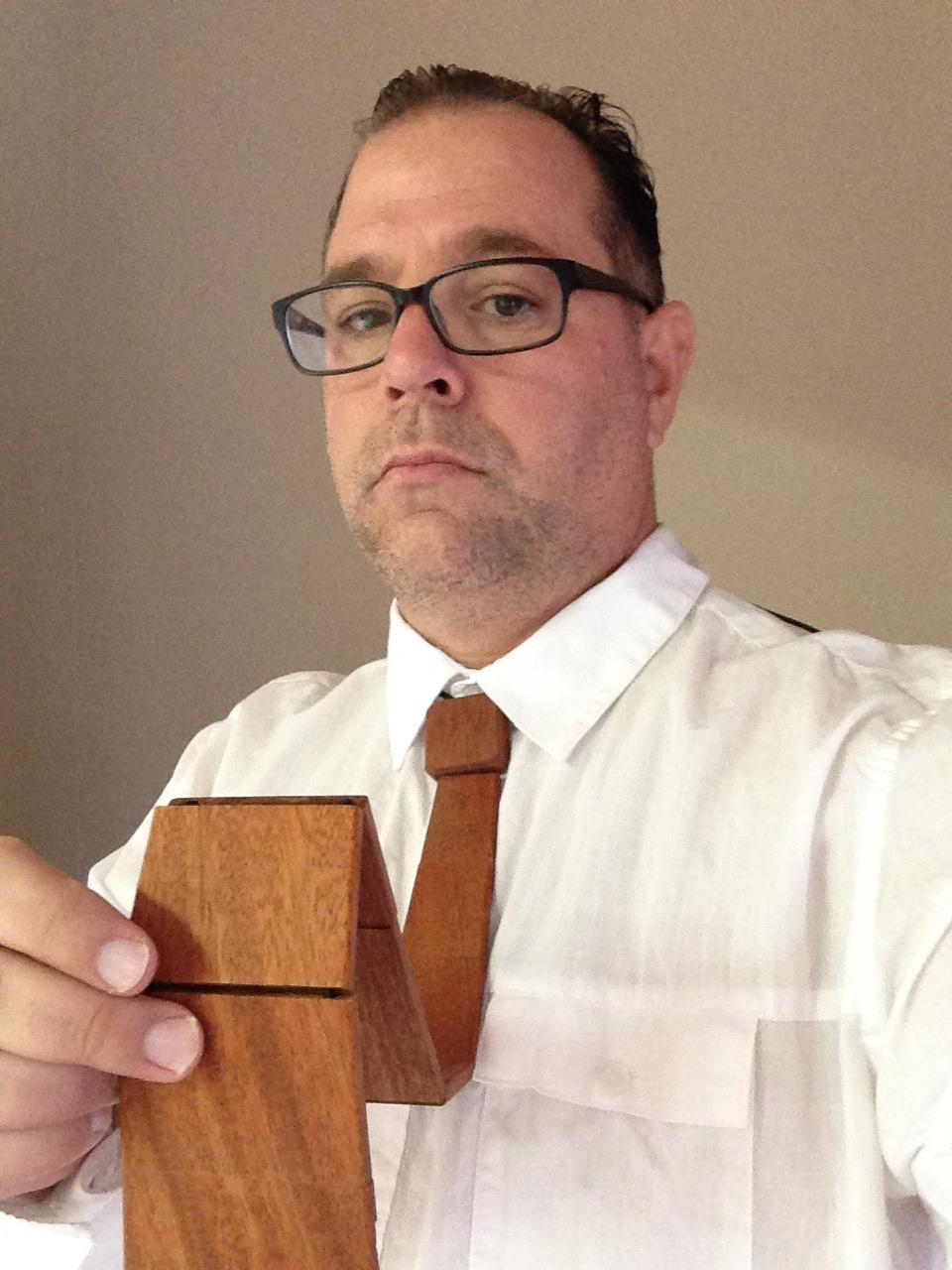 David Moye, a staff writer for HuffPost Weird News, demonstrates his incredible fashion sense by modeling a wooden tie.