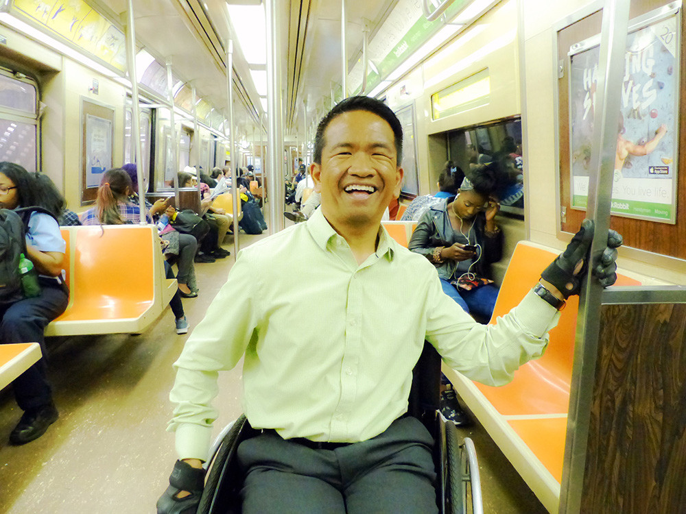 Chris Pangilinan, riding the MTA in 2016. (Photo credit Laura Lee Huttenbach.)