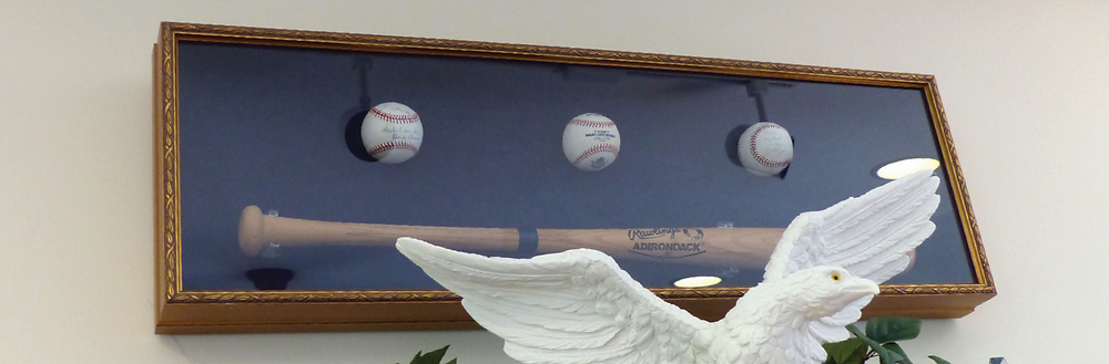 Norman Mineta's famous baseball bat, hanging in his office. (Photo credit Laura Lee Huttenbach).