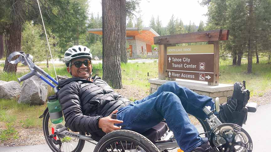 Chris, biking around Tahoe in 2016. (Photo credit Jessica Morse.)