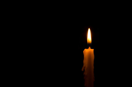 One light candle burning brightly in the