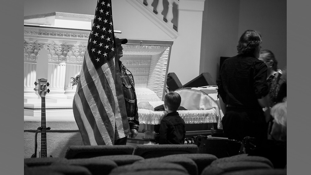 A boy stands in silent communion with his Grandfather as he visits with him one last time.