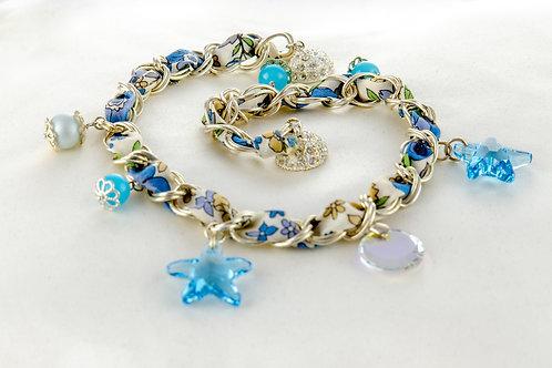 Bracelet océane orné d'un ruban Liberty, chaîne argenté et pendentifs en cristal