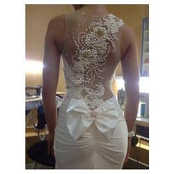 Pearled back bride