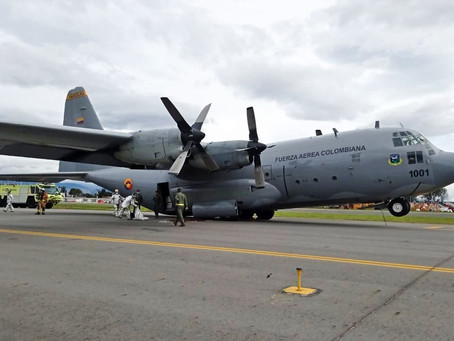 A Colombian Air Force Lockheed Martin C-130 main gear retracts  while taxiing