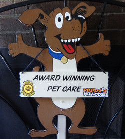 Hand painted dog with hanging sign