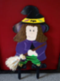 This cute little witch can't wait for Halloween with her raffia broom