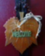Large leaf hanger with hand cut welcome,