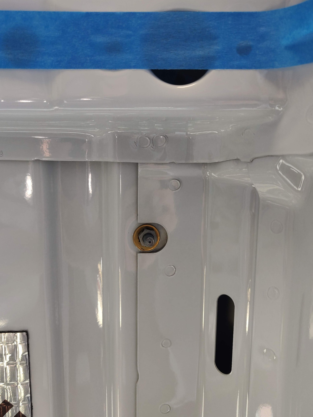 The inside of the Sprinter roof with the screw from the roof rails sticking through.