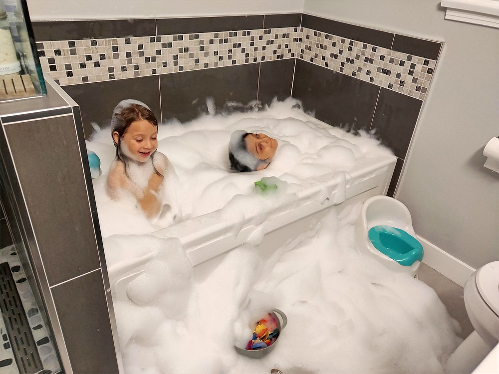 Leila and Dante with smiles on their faces going back to enjoying the bubbles after not getting a scary response from me