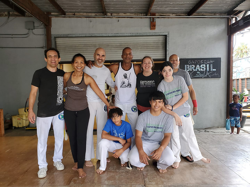 I am posing in a photo with participants from Capoeira Brasil's Saturday morning parent's class