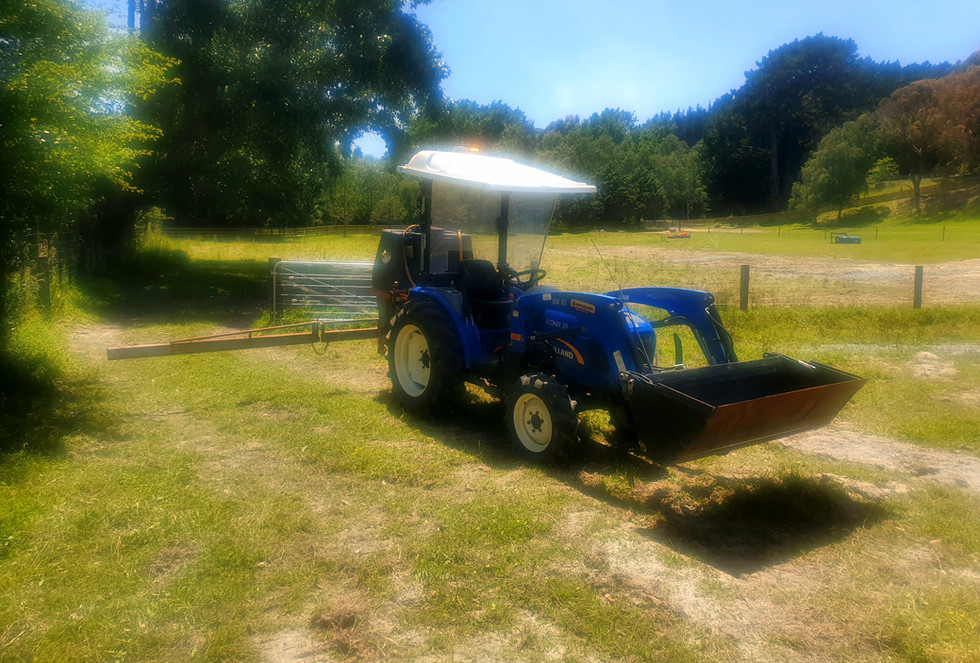Tractor Boom Spraying.jpg