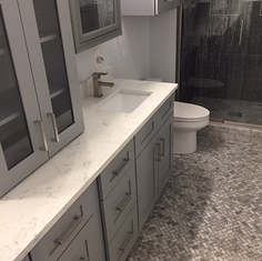Master bath flooring in carrara marble