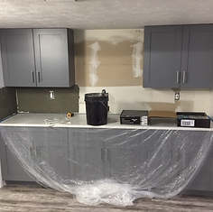 Wall is now the distance of the bar cabinets