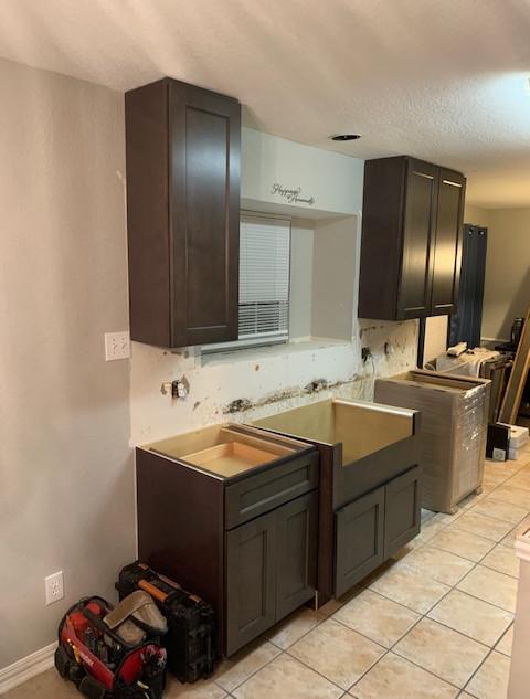 new kitchen cabinets being installed