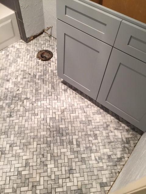 herringbone carrara marble floor renovaton
