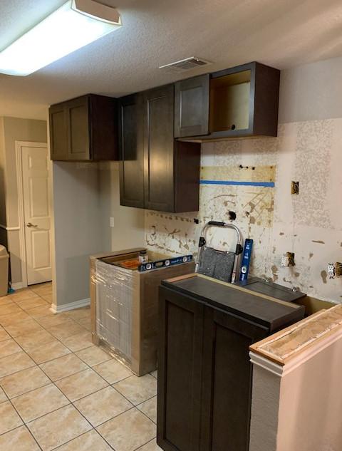 new kitchen cabinets being installed-2