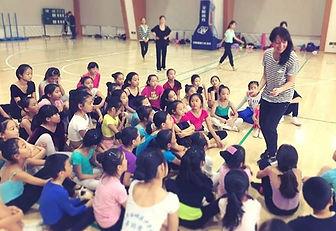 Julie Nguyen teaching Dance abroad.